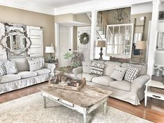 Farmhouse Living Room using neutral colors. Ikea couches and ideas for old doors and windows