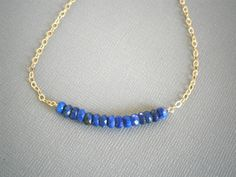 Row of Lapis Rondelles Gold Necklace by LisaDJewelry on Etsy, $29.00