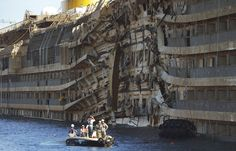 Members of the U.S. salvage company Titan and Italian firm Micoperi inspect the wreck of Italy's Costa Concordia cruise ship after emerging from water, near the harbor of Giglio Porto on Sept. 18. Salvage operators in Italy lifted the Costa Concordia cruise ship upright from its watery grave off the island of Giglio in the biggest-ever project of its kind. The ship was upright for the first time since the tragedy on Jan. 13, 2012, and led to applause and cheers in the port.