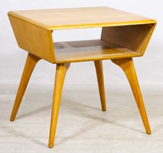Lot 64: Mid-Century Modern Lamp Table by Heywood Wakefield; Having an open lower surface; marked on bottom