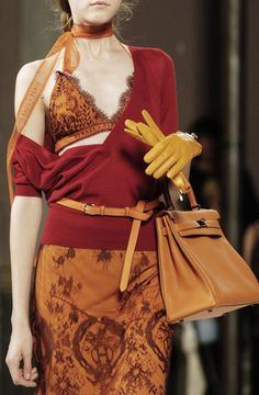 This ensemble is way too risqué for me; however, these colors are PERFECT for me. I also like the mustard skinny belt, gloves, and bag.