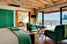 Imagine waking up to the sounds of the waves with beautiful views to Hout Bay, South Africa. Find out more about Tintswalo Atlantic Lodge Ocean Inspired Bedroom, Peacock Blue Bedroom, Chic Beach House, Cape Town Hotels, Fantasy Bedroom, Green Bedding, Beautiful Hotels, Hotels And Resorts, Luxury Hotels