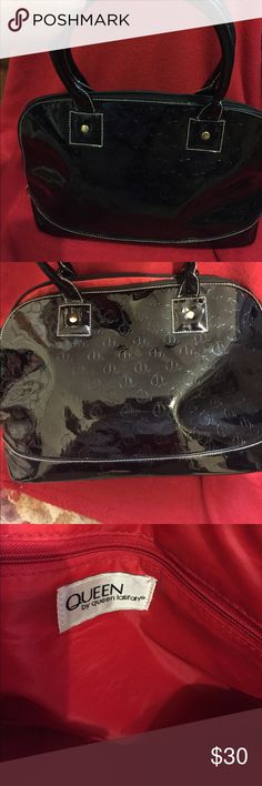 Queen Latifah Purse 👛 Black beauty shines. This is a Queen Latifah black patent bag 💼. No stains queen latifah Bags