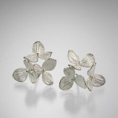 """These naturally beautiful and artful John Iversen hydrangea earrings are a Quadrum favorite. Featuring an arrangement of three bright sterling silver hydrangea blossoms, with a post back. The """"Medium 3 Part Hydrangeas"""" would make a lovely birthday, anniversary, or bridesmaid gift!"""