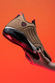 The Air Jordan 14 Winterized is the latest shoe in the Jordan collection to undergo a winter-inspired makeover. Instead of leather, the upper on this rugged new design is constructed from water-resistant nubuck panels in a boot-like Archaeo Brown shade.