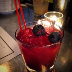 Loves Labor made with Kettle One vodka, concord grape, St. Germaine, & lemon