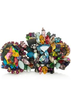 Appeals to my magpie sensibilities. Erickson Beamon confetti gunmetal plated Swarovski crystal cuff.