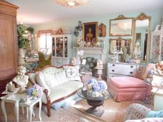 Living Room , Shabby Chic Style For Living Room : Shabby Chic Style Living Room With Statue And Vases And Indoor Plant And Round Glass Top Coffee Table And Pink Armless Chair And Loveseat And Mantel And Mirror And Buffet