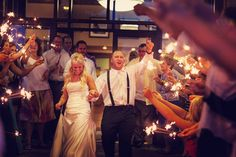 Ross and Karissa To make the night memorable, the newlyweds had a sparkler exit with their guests and the couple walked, danced, carried and kissed through the tunnel of loved ones chanting their names.
