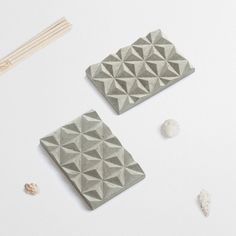 The concrete soap holder is designed to keep your soap dry and increase its life span. The soap dish is designed and handmade in Munich Germany. | Materials: special solid cast concrete with rubber feet. | Color: grey | Dimensions: H 1.5 x L 12 x W 8cm | Weight: 250 g  Minor irregularities in the surface are natural, no two will ever be the same.  (Plants and decorations are not included)