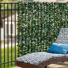 """For by the pool equipment  Faux Double Sided Leaves Privacy Screen 39"""" x 10' - Improvements by Improvements. $59.99. The Faux Double Leaves Privacy Screen is lightweight but durable to withstand the weather. This outdoor privacy screen is ideal for covering unattractive chain link fences. Decorative, flexible fencing features fabric leaves on both sides. Decorative, flexible fencing features fabric leaves on both sides. The Faux Double Leaves Privacy Screen is lightweight but durable to…"""
