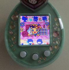 Tamagotchi-P met Sanrio Characters Mix Change pierce met Memetchi.