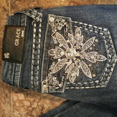 Grace in LA jeans Grace in LA jeans with amazing jeweled pockets, size 26, long length. I bought these from a fellow posher, and I LOVE them but they are way too long for me. Grace in LA Jeans