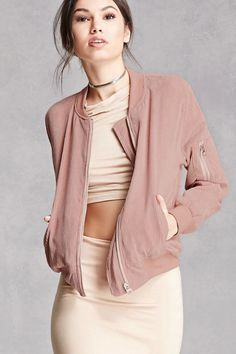 A corduroy bomber jacket featuring a zipper front, long sleeves, slanted front pockets, a zipper sleeve pockets, and ribbed trim. This is an independent brand and not a Forever 21 branded item.