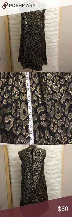 Gold and Black Calvin Klein Dress A little abstract The gold has little frills on it Great for a party or going on a date Calvin Klein Dresses Midi