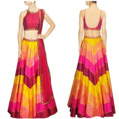 This set features a yellow, hot pink and magenta raw silk lehenga with zig-zag print. It is paired with magenta raw silk blouse with gold sequins embroidery in diamond pattern on the neckline and hem and cut-out detailing at back.  It also comes along with pink sequins embroidered net dupatta.  Title : Yellow, hot pink and magenta sequins embroidered lehengas set. Size : Free Color : Multi color Fabric : Raw Silk Type : Embroidered, Printed Occasion : Festive, Wedding, Ceremony..