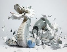 Photograph by German artist Martin Klimas of a ceramic dragon the moment of impact after being dropped (the sound of the crash sets off the camera).