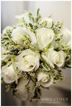 White rose wedding bouquet.  Classic choice for the simple bride or bridesmaid. #weddingbouquets #wedding #white #rose #bouquet