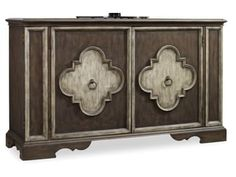 The 68 inch Two Door Console features two adjustable shelves behind each of the two doors with center partition. As well as two touch latch hidden side doors with one adjustable shelf behind each.