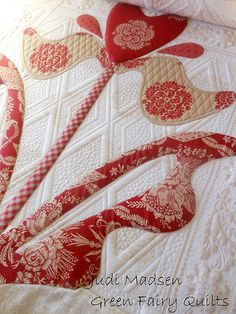 Thelma's quilt, Judi Madsen Quilting--like the quilting that goes thru the tan part of the appliqué