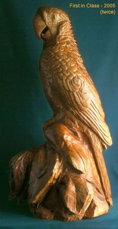 """Green Wing Macaw wood carving by Lorene - This large carving, of cherry, finished with oil urethane and buffed with wax, is 28"""" tall."""