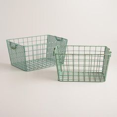 With hinged handles and a distressed blue finish, these baskets combine wire on two sides and punched metal on the others for striking, vintage-inspired style.