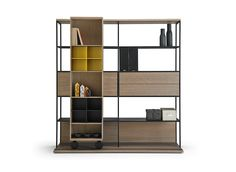 The highly customizable La Literatura can be configured to feature a hideaway desk and function as a shelving system against a wall or as a room partition.