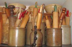 Antique wood rolling pins in crocks.