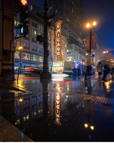 The Chicago Theater, a landmark of the city, is reflected in a puddle on a rainy evening along southern Lake Michigan. Chicago, Instagram Images, Instagram Posts, Lake Michigan, Photojournalism, National Geographic, Wander, Times Square, Around The Worlds