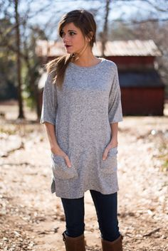 """A tunic like this is needed in every girl's wardrobe! The color is divine for the season and that super soft material makes for the kind of wear you will never want to take off! It's great for layering and so easy to style, too! <br /> <br />Bra-friendly! Material has generous amount of stretch. Pockets. Button details. <br />Miranda is wearing the small. <br /> <br />Length from shoulder to hem: S- 30""""; M- 31""""; L- 32"""". <br /> <br />Sizes fit: <br />Small- 0-4; Medium- 6-8; Large- 10"""
