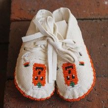 WHITE LEATHER BEADED BABY MOCCASINS WITH PUMPKIN DESIGN by JANET WHITEMAN - CHEYENNE