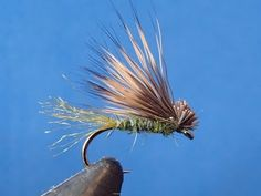 Olive X Caddis... I'd add a single strand of Flashabou as a ribbing, and I'd try tying them with a dark brown head,  covering the deerhair butts.  Also,  in tan with an Amber trailing shuck.