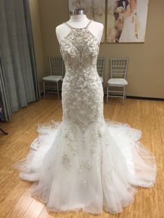 This sparkling silver beaded wedding dress with a unique cross back is a fashion forward statement brides will want to make! (Style#D2403  Designer: Essense of Australia) #WeddingDress #WeddingGown #Married #Bridal #BridalInspo
