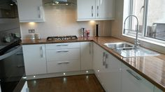 Another one of the kitchens fitted by the kitchen specialist glasgow! We love the wood-effect worktops and under cabinet lighting. Gloss Kitchen, Kitchen Cabinets, Wood Effect Worktops, Under Cabinet Lighting, Glasgow, Backsplash, Kitchen Ideas, Kitchens, Handle