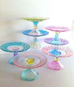 Hand Painted Pastel Cupcake Stand, but you could make these with candle sticks, beautiful plates, and the right glue.