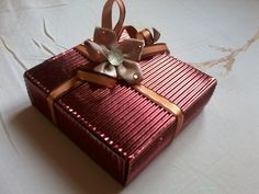 DIY gift box using glossy corrugated paper and fabric flower adornment