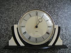 "A Smiths Art Deco ""30 hours"" Chrome & Bakelite Clock circa 1940's . Made in England on the front"