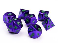 Purple w/green Metal (zinc) rpg dice from CrazyColorSupplies on Etsy.