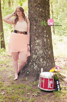 Girl senior portrait session with snare drum.