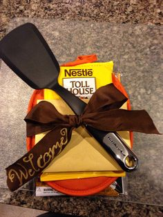 Welcome gift for a new neighbor. Potholder, spatula, cookie mix.