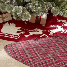 Traditional Tartan Tree Skirt | Festive in red and green with a timeless plaid pattern, this tree skirt is the finishing touch for your Christmas tree display.