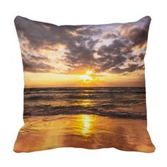 Beautiful throw pillow featuring a stunning shot of the golden sunrise over the golden sands and sparkling waters of Surfers Paradise, Australia.