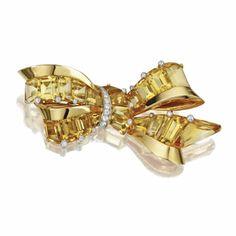 18 KARAT GOLD, TOPAZ AND DIAMOND BOW BROOCH, OSCAR HEYMAN & BROTHERS, J.E. CALDWELL & CO., 1941 - Sotheby's