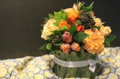 {Helebores Covered Bowl} Flower arrangement by Tempting Tulips - Peach and Yellow Styling