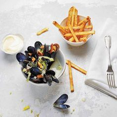 Moules Frites: a classic recipe that calls for steaming mussels in white wine, which lends acidity and creates a flavorful sauce.