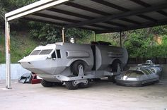 "The Landmaster from ""Damnation Alley"" -=AND=- one of the gullwing cars from ""Logan's Run""! In the same pic! Awesomesauce."