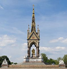 The Albert Memorial is situated in Kensington Gardens, London, England, directly to the north of the Royal Albert Hall. It was commissioned by Queen Victoria in memory of her beloved husband, Prince Albert who died of typhoid in 1861. The memorial was designed by Sir George Gilbert Scott in the Gothic Revival style.