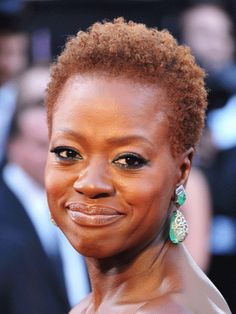 Viola Davis How to Do It Yourself: These really short hair styles should be cut every four to five weeks.  To style a pixie, use a light shine product before you blow it out to add shine without making the hair look too greasy.  Don't use any round brushes (They will make the hairstyle bubble out).  You can finish with a small flat iron if you'd like to add some definition to the layers along with some light hold hairspray.   - Redbook.com