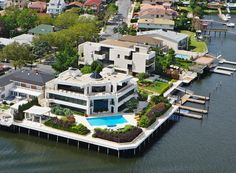 Brooklyn's largest and most prestigious waterfront property. A private gated compound on Brooklyn's offering more than 60,000 sq. ft. inside and out, this gated property has two separate houses providing 23,000 square feet of interior state of the art living spaces, including seven master bedroom suites with full water views, 14 full baths, four kitchens, five staff rooms, elevators to all levels, media rooms, gatehouse and indoor parking for seven cars.