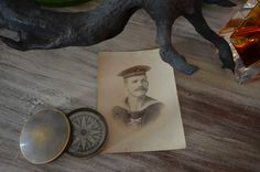 Old black and white photos are readily available and bring a vintage feel to your coastal decor.
